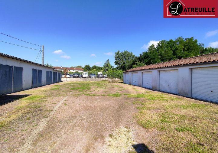 A louer Garage Saintes   R�f 1701151 - Latreuille immobilier