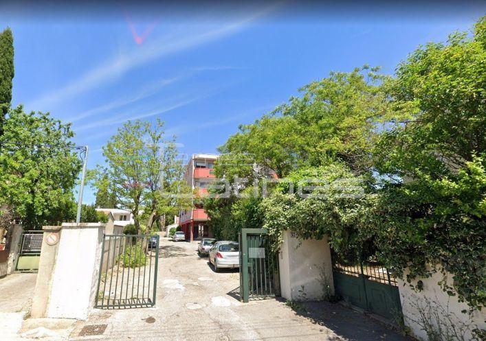 A louer Parking intérieur Nimes | Réf 30144396 - Terres latines